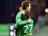 Saint Etienne's French midfielder Benjamin Corgnet (L) celebrates with a teammate after scoring a goal during the French L1 football match Saint-Etienne (ASSE) vs Nantes (FCNA) on December 21, 2013