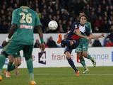 Paris Saint-Germain's Uruguayan forward Edinson Cavani scores during the French League Cup round of sixteen football match against Saint-Etienne on December 18, 2013