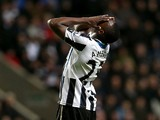 Newcastle United's Nigerian striker Shola Ameobi reacts to a miss in goal during the English Premier League football match between Newcastle United and West Bromwich Albion at St James' Park in Newcastle upon Tyne on November 30, 2013
