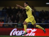 Jeremy Perbet of Villarreal celebrates after scoring during the La Liga match between Villarreal CF and Sevilla FC at El Madrigal on December 21, 2013