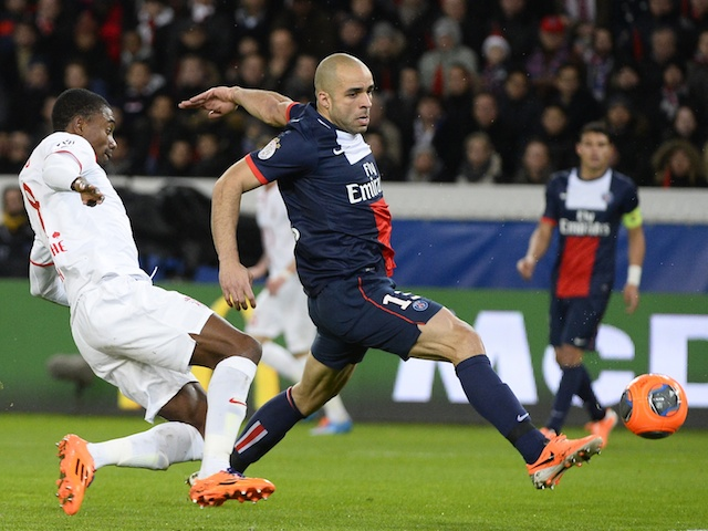 Paris Saint-Germain's Brazilian defender Alex vies for the ball with Lille's Ivorian forward Salomon Kalou during the French L1 football match on December 22, 2013