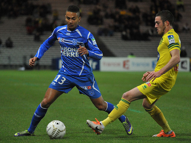 Auxerre's Axel Ngando and Nantes' Jordan Veretout in action during their French League Cup match on December 17, 2013