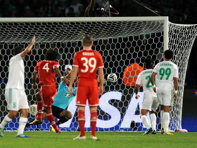 Dante of FC Bayern Munchen scores the opening goal during the FIFA Club World Cup Final match between FC Bayern Munchen v Raja Casablanca at Marrakech Stadium on December 21, 2013