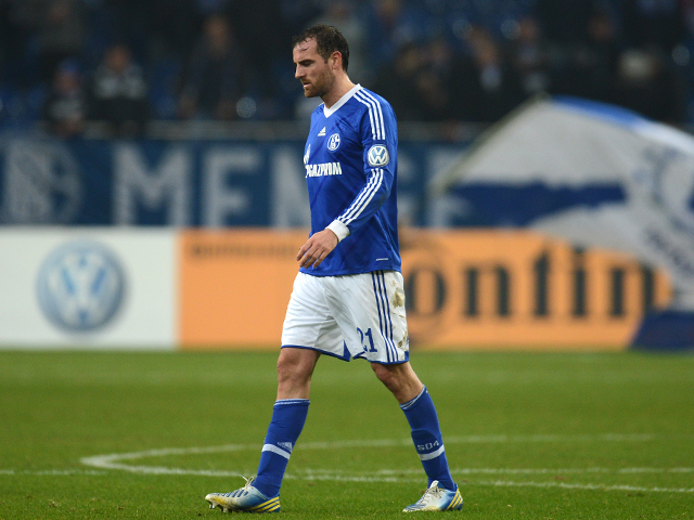 Schalke's defender Christoph Metzelder reacts after the German Cup football match Schalke 04 vs FSV Mainz 05 in Gelsenkirchen, western Germany, on December 18, 2012
