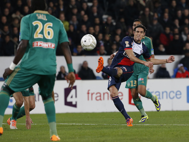 Paris Saint-Germain's Uruguayan forward Edinson Cavani scores during the French League Cup round of sixteen football match against Saint-Etienne on December 18, 2013