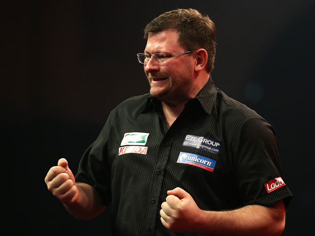 James Wade of England celebrates winning his first round match against Darren Webster of England during the Ladbrokes.com World Darts Championship on Day Six at Alexandra Palace on December 19, 2013