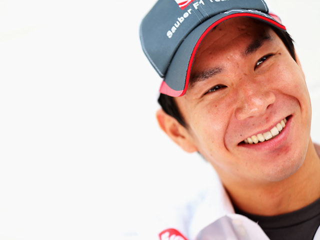 Kamui Kobayashi of Japan and Sauber F1 is seen outside his team hospitaly unit during previews for the Brazilian Formula One Grand Prix on November 22, 2013