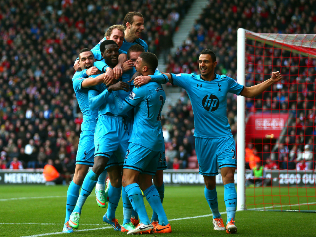 Emanuel Adebayor of Spurs celebrates with teammates after scoring his team's third goal during the Barclays Premier League match between Southampton and Tottenham Hotspur at St Mary's Stadium on December 22, 2013