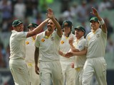 Mitchell Johnson of Australia celebrates after he dismissed Jonny Bairstow of England during day one of the Fourth Ashes Test Match between Australia and England at Melbourne Cricket Ground on December 26, 2013