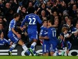 Chelsea's Eden Hazard celebrates with teammates after scoring his team's opening goal against Liverpool during their Premier League match on December 29, 2013