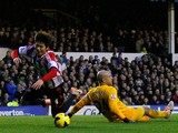 Tim Howard of Everton fouls Ki Sung-Yueng of Sunderland inside the penalty box during the Barclays Premier League match between Everton and Sunderland at Goodison Park on December 26, 2013