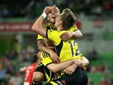 Stein Huysegems of the Phoenix celebrates with team-mate Tyler Boyd of the Phoenix after scoring a goal during the round 12 A-League match between Melbourne Heart and the Wellington Phoenix at AAMI Park on December 27, 2013