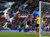 Roland Lamah of Swansea City heads in their first goal past Brad Guzan of Aston Villa during the Barclays Premier League match on December 28, 2013