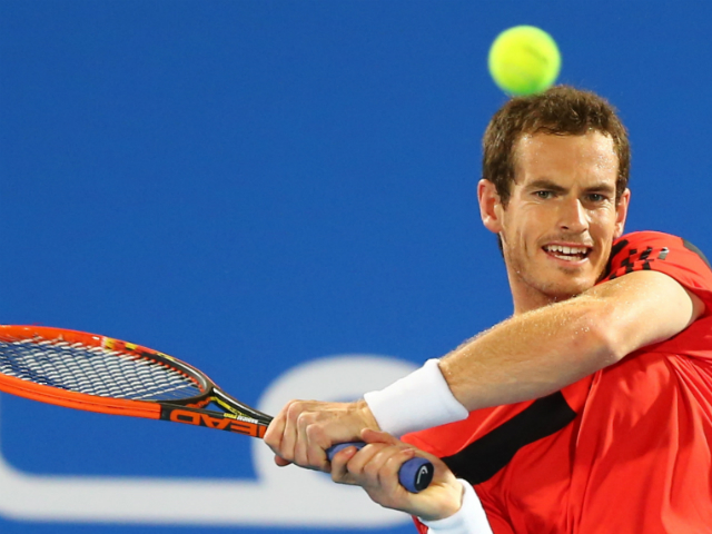 Andy Murray of Great Britain returns the ball to France's Jo-Wilfried Tsonga during their Mubadala World Tennis Championship match in the Emirati capital Abu Dhabi on December 26, 2013