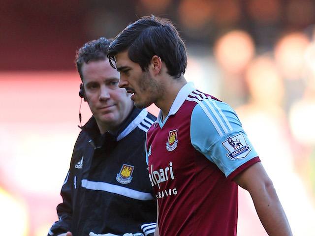 James Tomkins of West Ham leaves the field of play with an injury during the Barclays Premier League match against West Brom on December 28, 2013