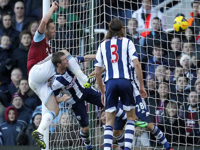 West Ham United's English midfielder Kevin Nolan scores their third goal against West Bromwich Albion on December 28, 2013