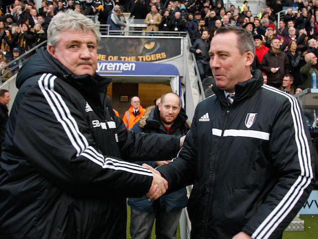 Steve Bruce manager of Hull City greets Rene Meulensteen manager of Fulham before the Barclays Premier League match between Hull City and Fulham at KC stadium on December 28, 2013