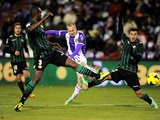 Real Betis' Daniel Larsson takes a shot past the Valladolid defence during their La Liga match on January 4, 2013