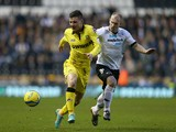 Michael O'Halloran of Tranmere Rovers is tackled by Gareth Roberts of Derby County during the FA Cup with Budweiser Third Round match between Derby County and Tranmere Rovers at Pride Park Stadium on January 5, 2013