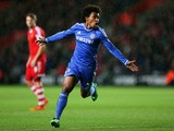 Willian of Chelsea celebrates after scoring his team's second goal during the Barclays Premier League match between Southampton and Chelsea at St Mary's Stadium on January 1, 2014