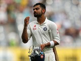 Virat Kohli of India walks from the field after being dismissed for 169 during day three of the Third Test match between Australia and India at Melbourne Cricket Ground on December 28, 2014