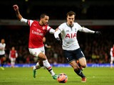 Arsenal's Theo Walcott and Tottenham's Vlad Chiriches in action during their FA Cup third round match on January 4, 2013