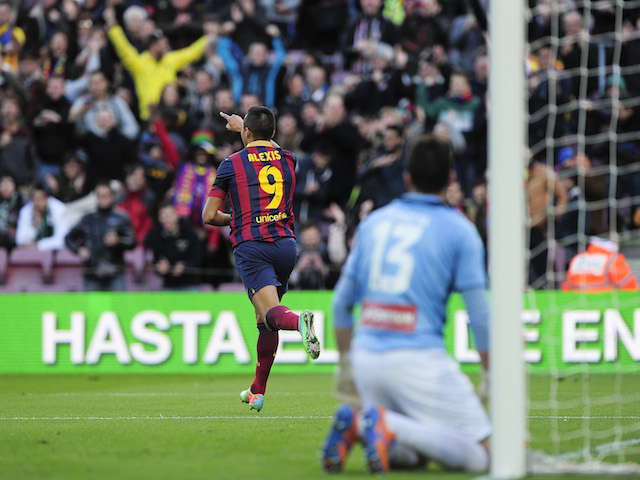 Barcelona's Chilean forward Alexis Sanchez celebrates after scoring during the Spanish league football match FC Barcelona vs Elche CF at the Camp Nou stadium in Barcelona on January 5, 2014
