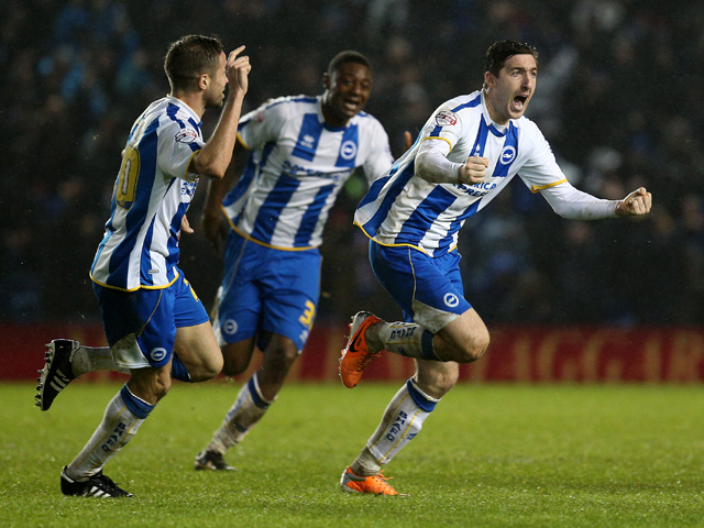 Stephen Ward of Brighton celebrates scoring a late equaliser with team mate Matthew Upson during the Sky Bet Championship match between Brighton & Hove Albion and AFC Bournemouh at The Amex Stadium on January 01, 2014