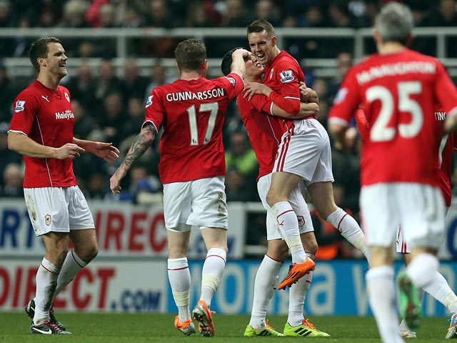 Cardiff's Craig Noone is congratulated by teammates after scoring his team's first goal against Newcastle during their FA Cup third round match on January 4, 2013