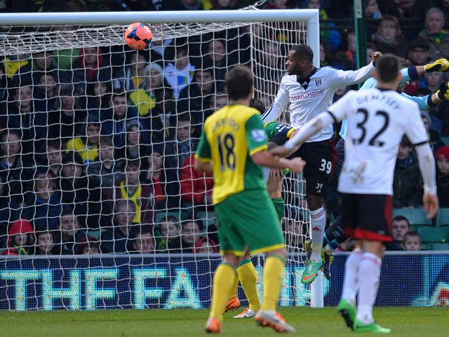 Fulham's Darren Bent scores the opening goal against Norwich during their FA Cup third round match on January 4, 2013