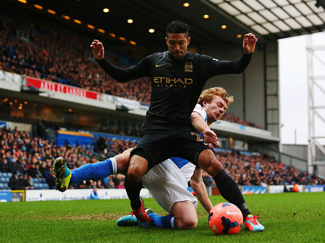 Manchester City's Gael Clichy and Blackburn's Chris Taylor in action during their FA Cup third round match on January 4, 2013
