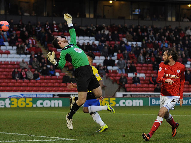 Barnsley's Jim O'Brien scores the opening goal against Coventry during their FA Cup third round match on January 4, 2013