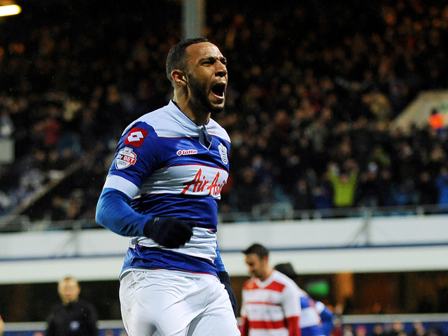 Matt Phillips of Queens Park Rangers celebrates scoring 1st goal as a dejected Ross Turnbull of Doncaster Rovers sits on the ground during the Sky Bet Championship match between Queens Park Rangers and Doncaster Rovers at Loftus Road on January 1, 2014