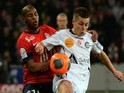 Lille's French defender Dijbril Sidibe vies with Reims' forward Nicolas de Preville during the French L1 football match Lille vs Reims, on January 12, 2014