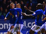 Jamie Vardy of Leicester celebrates scoring to make it 4-1 with team mates during the Sky Bet Championship match between Leicester City and Derby County at The King Power Stadium on January 10, 2014
