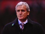 Stoke City manager Mark Hughes looks on prior to kick-off against Liverpool during their Premier League match on January 12, 2014