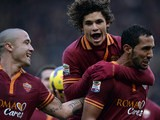 Roma's Mehdi Benatia celebrates with teammates after scoring his team's fourth goal against Genoa during their Serie A match on January 12, 2014