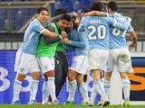 Miroslav Klose of Lazio celebrates with his teammates after scoring the opening goal during the Serie A match against Inter Milan on January 6, 2014
