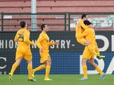 Luca Toni of Hellas Verona FC celebrates with his team-mates after scoring the opening goal during the Serie A match between Udinese Calcio and Hellas Verona FC at Stadio Friuli on January 6, 2014
