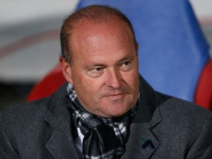Real Betis manager Pepe Mel looks on before kick-off against Lyon in their Europa League match on November 28, 2013