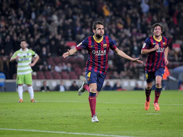 Barcelona's midfielder Cesc Fabregas (C) celebrates his goal during the Spanish Copa del Rey (King's Cup) FC Barcelona vs Getafe CF on January 8, 2014