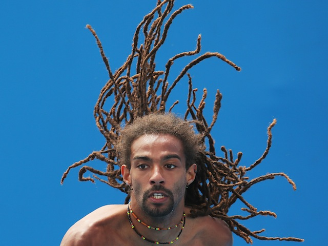 Dustin Brown of Germany practices for the Australian Open in Melbourne on January 6, 2014