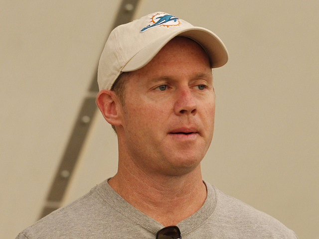 General manager Jeff Ireland of the Miami Dolphins watches players during the rookie camp on May 3, 2013