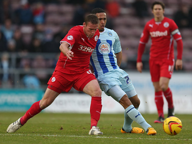 Coventry's Jordan Clarke and Crawley's Andy Drury in action during their League One match on January 12, 2014