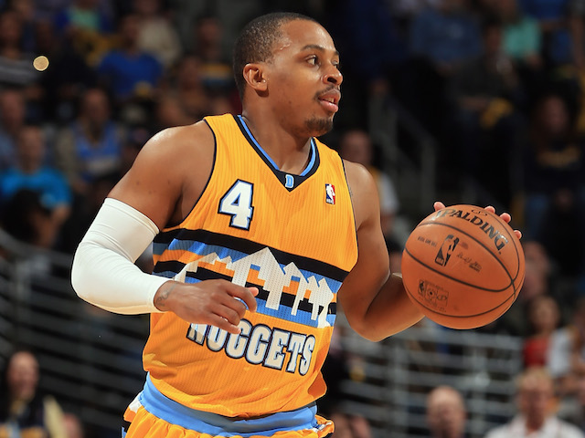 Randy Foye of the Denver Nuggets controls the ball against the Portland Trail Blazers at Pepsi Center on November 1, 2013