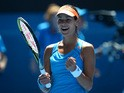 Ana Ivanovic celebrates after her win over Serena Williams in their Australian Open fourth round match on January 19, 2014