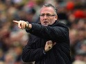 Paul Lambert, manager of Aston Villa gives instructions during the Barclays Premier League match between Liverpool and Aston Villa at Anfield on January 18, 2014