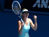 Russia's Maria Sharapova celebrates winning match point against Italy's Karin Knapp in their women's singles second round match on day four of the 2014 Australian Open tennis tournament in Melbourne on January 16, 2014