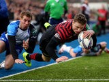 Saracens' Chris Ashton dives over to score his team's first try against Connacht during their Heineken Cup match on January 18, 2014