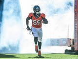 Denver Broncos' Danny Trevathan runs onto the field in the game against Washington Redskins on October 27, 2013
